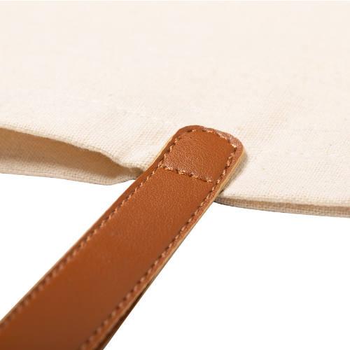Mulepose med tryk og PU læder stropper model daypok natur detalje